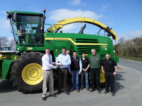 Pic of the Certified Dealer Specialisation Award being presented at TAG Narberth by John Deere Territory Manager, Darren Roe, to TAG Narberth Branch Manager, Matthew Blackburn.