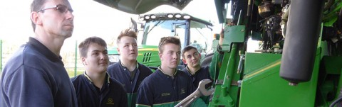 Richard Allard (left) Service Manager at Tallis Amos Group, talking through the basics of a combine harvester with apprentice technicians